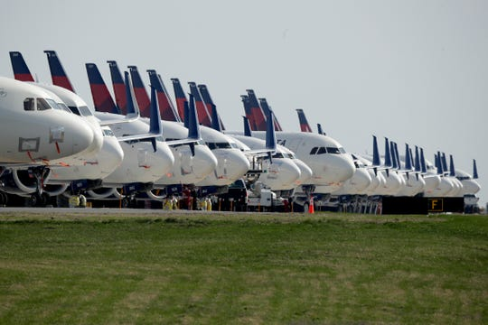 Several dozen mothballed Delta Air Lines jets are parked at Kansas City International Airport in Kansas City, Mo. on April 1.