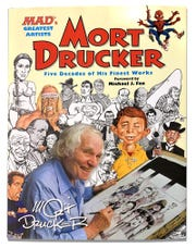 "Mort Drucker is seen on the cover of ""Mort Drucker: Five Decades of His Finest Works."" Drucker, the Mad Magazine cartoonist who for decades lovingly spoofed politicians, celebrities and popular culture, died Thursday at 91."
