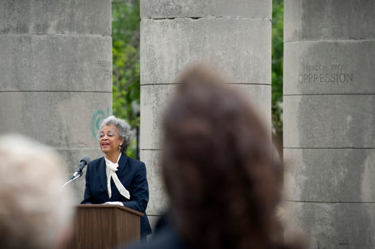 The Rev. Veltri Taylor, pastor of First Ebenezer Baptist Church, offers the first of many prayers at the National Day of Prayer ceremony at the Four Freedoms Monument in Evansville, Ind., Thursday afternoon, May 5, 2016. Taylor's father, the Rev. F.P. Miller, was honored with a moment of silence at the event he attended for more than 20 years before his death in December of 2015.