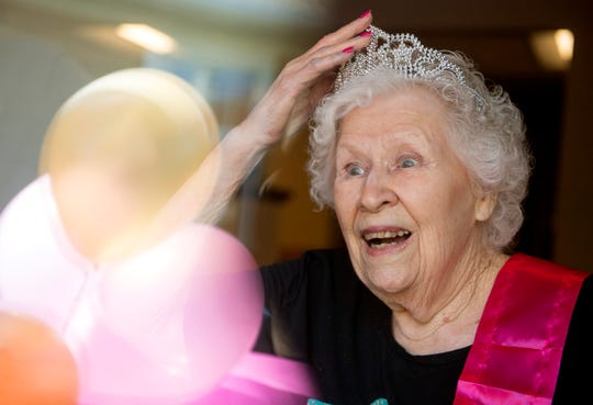 Helen Miller is surprised by friends and family with a party for her 90th birthday at The Village at Hamilton Pointe on Thursday afternoon, April 9, 2020. Due to the spread of COVID-19, the senior living community has stopped visitation from family and friends and the only form of communication has been through windows and video applications.