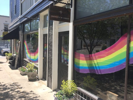 Rainbows fill the windows of Flutter in Downtown Newburgh.
