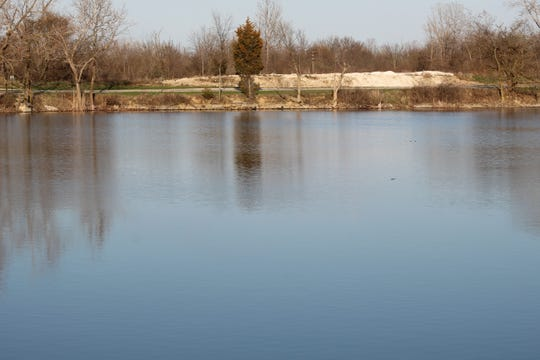White Star Park Quarry, seen here Wednesday, is a popular fishing destination for residents. A public rainbow trout fish release at the quarry that had been set for Friday has been delayed until further notice.