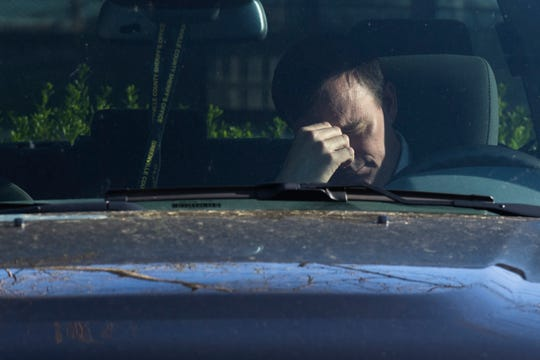 Greenville County Sheriff Hobart Lewis bows his head during 20 minutes of prayer in the parking lot at Hillcrest Hospital in Simpsonville Thursday, April 9, 2020.