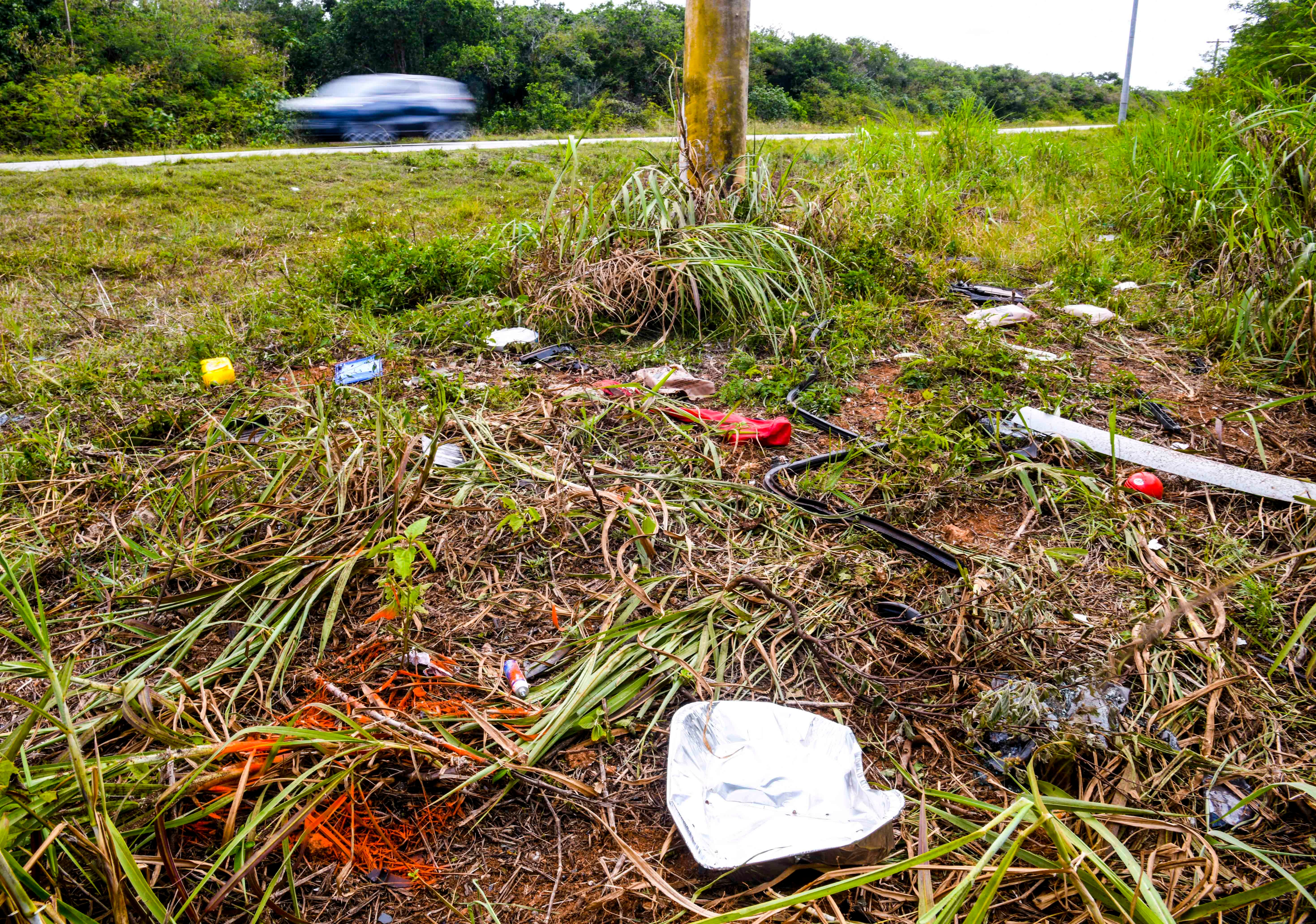 A debris field of car parts, personal items and paint markings left behind by the Guam Police Department's Highway Patrol Division, can be found at the site of a fatal auto-pole collision on Route 15, near the former Andersen South military housing, that claimed the life of a male driver during the early morning hours of Thursday, April 9, 2020.