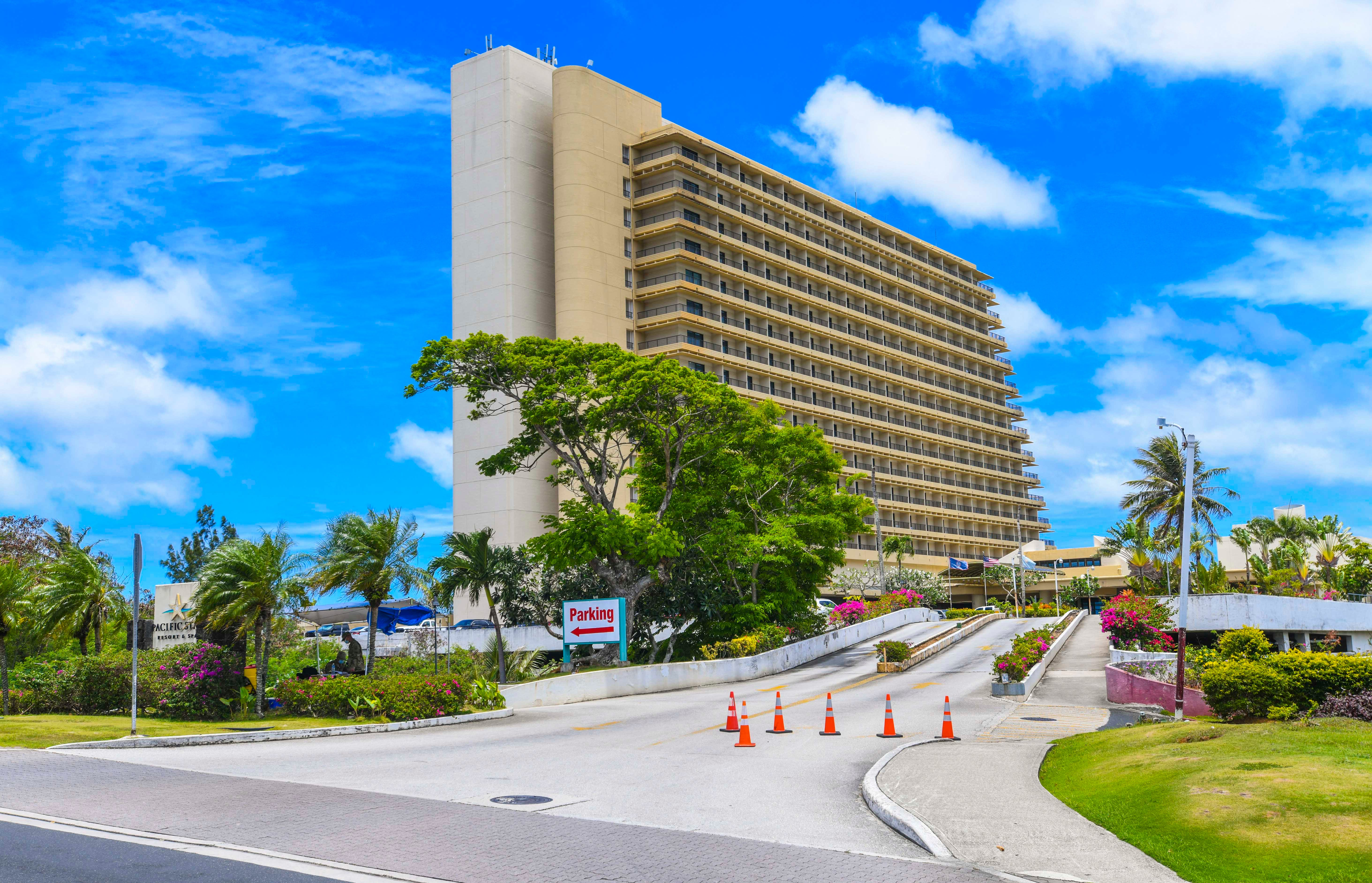 Traffic cones warn drives of a security checkpoint, monitored by Guam National Guard personnel, at the driveway entrance to the Pacific Star Resort & Spa in Tumon on Thursday, April 9, 2020.