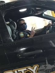 Iowa City Police Officer James Sandifer using personal protective equipment April 8, 2020, in Iowa City.