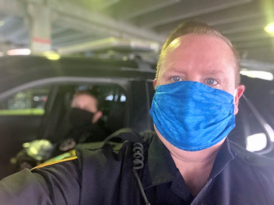 Iowa City Police officers Bob Hartman and Becki Sammons wearing personal protective equipment April 8, 2020, in Iowa City.