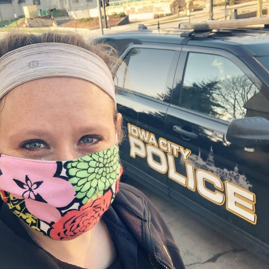Iowa City Police Officer Ashley Jay wears personal protective equipment April 8, 2020, in Iowa City.