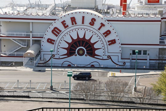 A lone vehicle passes through the empty Ameristar Casino parking lot in Vicksburg, Miss., Tuesday, March 17, 2020. All of Mississippi's state-regulated casinos were ordered closed by midnight Monday to limit the spread of the new coronavirus.