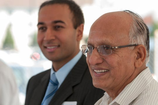 Alpesh Patel, left, the CEO of Kana Hotel Group and his father Kanti Patel who started the Kana Hotel Group in the late 1970  at the party celebrating the company's newest property, an Embassy Suites on Parkside Drive in West Knoxville on Thursday, Oct. 25, 2012.