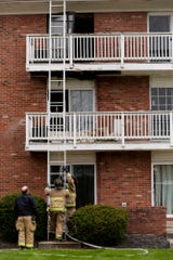 Firefighters work the scene of a balcony fire that spread inside and damaged the flooring of a third floor apartment and ceiling of a second floor apartment at Launch Apartments, 400 North River road, Thursday, April 9, 2020 in West Lafayette. The cause of the fire is still under investigation. No injuries were reported.