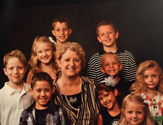 Helen Pratt, shown here surrounded by her grandchildren, died on April 6 from complications of COVID-19.