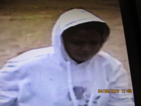 Image of a person of interest sought in a theft at a dairy farm in Manitowoc County.