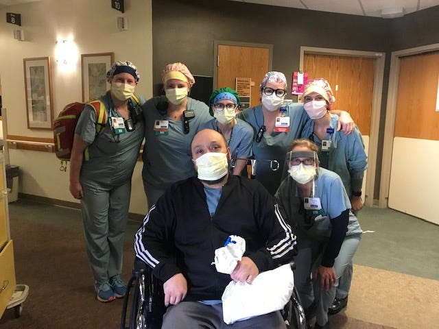 Leo, whose last name was not released by Froedtert Hospital, poses with staff before he was released April 9 after being hospitalized since March 20 with the coronavirus. The 43-year-old was put on a ventilator for eight days.