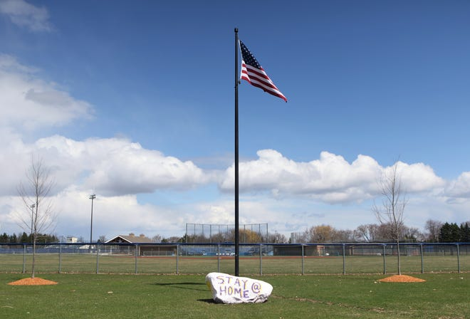 A rock located right outside Brookfield Central High School's baseball field sends a message to stay at home during the coronavirus pandemic. Schools across the state were closed from mid-March through the end of the school year.