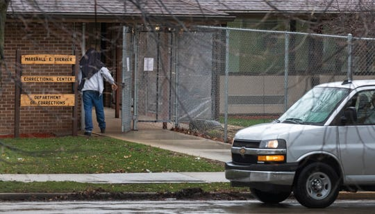 Offenders return to the Marshall E. Sherrer Correctional Center in Milwaukee after returning in a state-owned van from their work-release shift at Union Supply Group in Menomonee Falls, which holds a contract with the Department of Corrections.