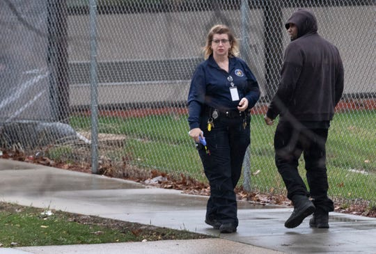 A correctional officer meets an offender returning to Marshall E. Sherrer Correctional Center after a shift on work release at Union Supply Group in Menomonee Falls, which holds a contract with the Department of Corrections.