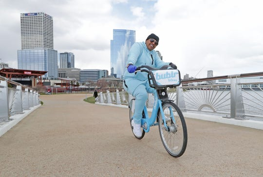 C. Burke, of Milwaukee, rides a Bublr bike through Lakeshore State Park in Milwaukee on Thursday, April 9, 2020.  In the wake of the coronavirus, Gov. Tony Evers directed the state Department of Natural Resources to close 40 Wisconsin state parks, forests, recreational and state natural areas, most of them in southern Wisconsin, due to record attendance over the first two weeks of April.  Photo by MIKE DE SISTI / MILWAUKEE JOURNAL SENTINEL