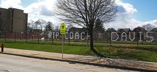 A memorial has been erected outside Milwaukee's Washington High School for Ralph Davis, the school's basketball and track coach who died of COVID-19 complications March 25.