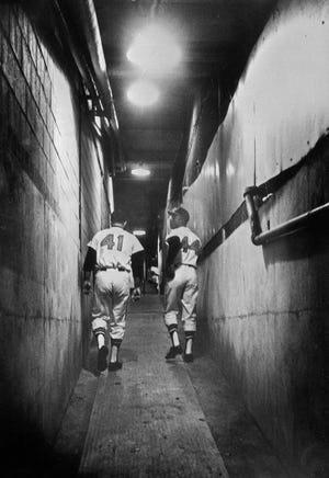 Braves sluggers Eddie Mathews (41) and Hank Aaron walked up the ramp and out of Milwaukee after the final game at the 1965 season.