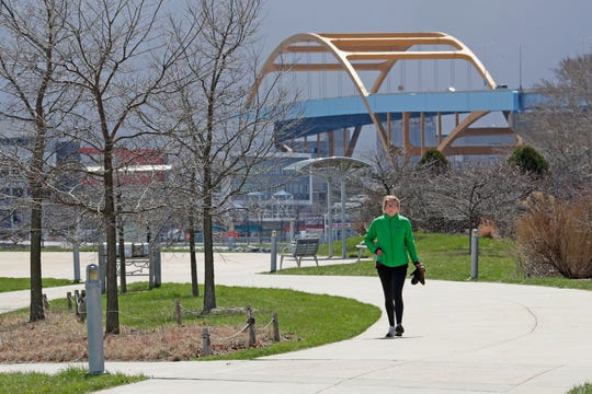 Cheri Meyer of Milwaukee takes a walk Thursday at Lakeshore State Park in Milwaukee.