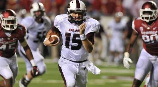 ULM quarterback Kolton Browning (15) completed 42-of-67 passes for 412 yards, three touchdowns and one interception in the Arkansas upset and ran for the game-winning score.