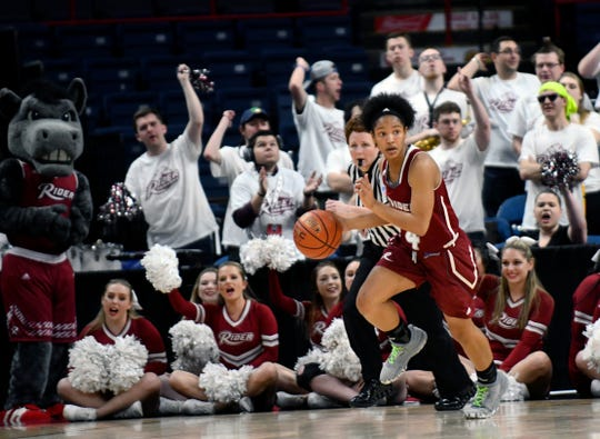 Rider guard Stella Johnson (4) moves the ball against Quinnipiac during the first half of an NCAA college basketball game in the championship of the Metro Atlantic Athletic Conference tournament on Monday, March 6, 2017, in Albany, N.Y. (AP Photo/Hans Pennink)