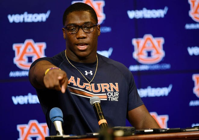Auburn linebacker K.J. Britt speaks at a press conference.