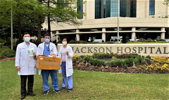 Three medical doctors of Jackson Hospital received face masks donated by the Central Alabama Association of Chinese (CAAC)