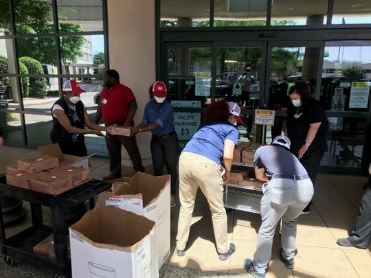 Hyundai workers drop off lunches Thursday for healthcare workers at Jackson Hospital in Montgomery.