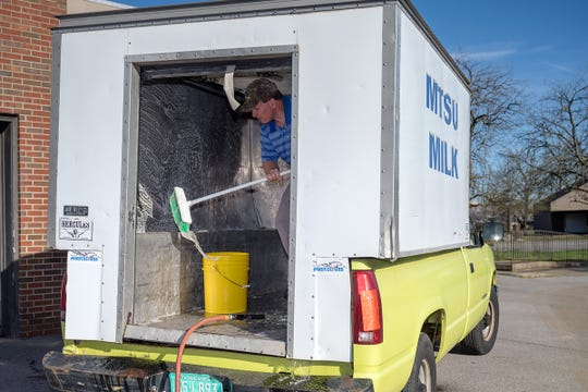 MTSU milk processing plant manager Steve Dixson cleans the delivery truck cooler before milk from the plant is brought on board and delivered to on- and off-campus venues.