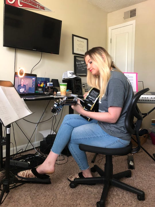 Country music singer-songwriter Sarah Harralson participates in Musicians On Call's virtual bedside performance program April 9.