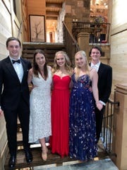 Ensworth senior Carrie Elcan attended a 'Zoom Prom' with about 60 of her roughly 100 classmates. Her family celebrated with her, and her sisters and their boyfriends – from left, Baxter Ingram, Lauren Elcan, Carrie Elcan, Cate Elcan and Connor Fair – also dressed up for the event.