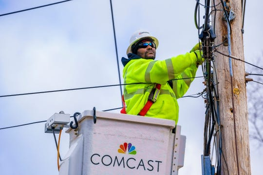 A Comcast technician maintains connections on a telephone pole. As more Tennesseans access work, school, news and government from home, internet technicians play an increasingly vital role in the COVID-19 response.