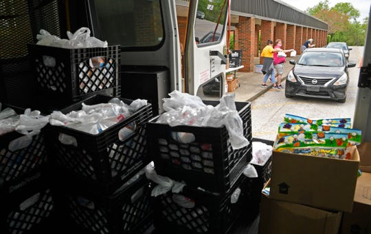 Franklin Special School District prepared and distributed meals to school children in Franklin, Tenn. Wednesday, April 8, 2020.