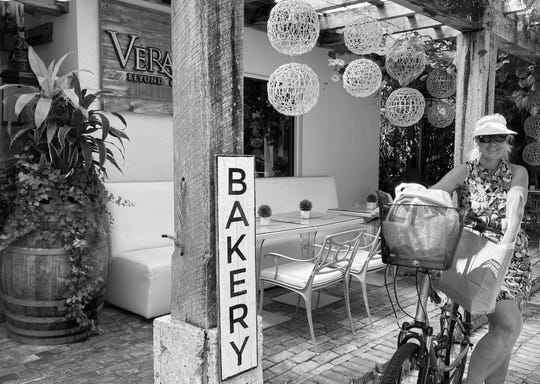 A customer picks up fresh baked goods at Hotel Escalante in downtown Naples. The hotel  has opened a new bakery in its kitchen, in partnership with Yannick and Ana Brendel, to serve the community and keep its employees on the payroll amid the coronavirus pandemic.