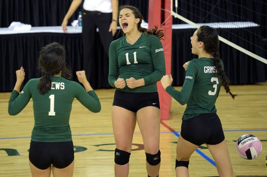 Seacrest's Emily Hancock (11) celebrates with teammates during the Class 2A semifinals in Kissimmee on Nov. 11, 2014.