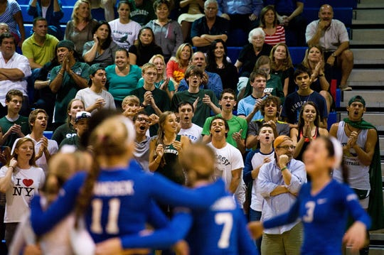 Seacrest fans celebrate during a Class 2A regional championship volleyball game in 2013. The Stingrays won the 2A title in 2013, becoming the first volleyball team from Collier County to win a state championship.
