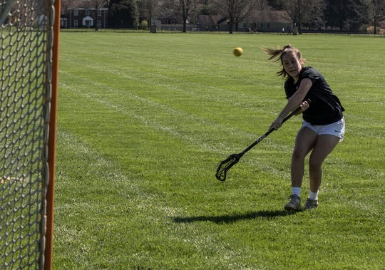 Granville senior Sophie Shaw shoots at the field in front of the Bryn Du Mansion earlier this week. Shaw, an All-American, led the Blue Aces to a 17-win season in 2019 and remains hopeful they will have an opportunity to return to the field in May.