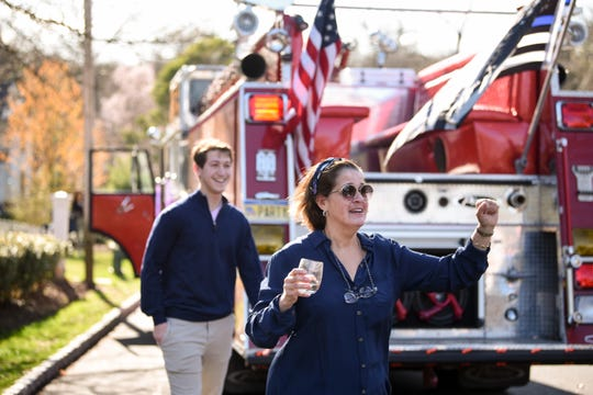 Steve Baskinger has a business where he rents out a fire truck for parties called Fire Party Patrol. Sue Weintraub reacts having successfully surprised her son Max Weintraub on his 20th birthday on Wednesday April 08, 2020 in Montclair, NJ.