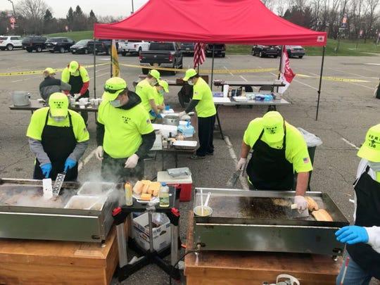 MERK volunteers cook hot meals for healthcare workers at the Bergen Community College testing site in Paramus on April 5.