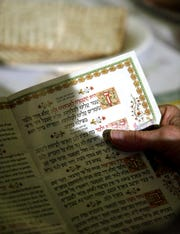 The Haggadah is the traditional prayer book used during passover.  A pre-passover service was conducted at the YM-YWHA (Young Men's - Young Women's Hebrew Association) of North Jersey in Wayne. Thursday, April 14, 2005.