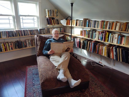 Jim Beckerman, in his home library