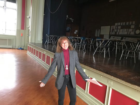 Classical Academy's chief administrator in the gym/auditorium of the charter school.