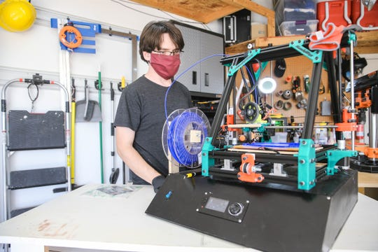 Michael Harris makes face mask shields and other items via a 3D printer in his Las Cruces garage on Thursday, April 9, 2020, to equip area medical staff faced with a shortage of personal protective equipment.