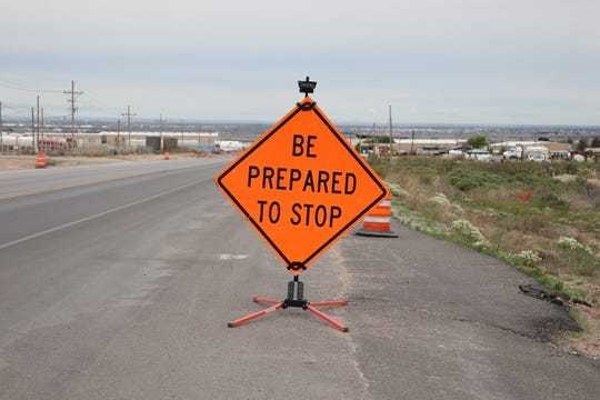 A sign tells commuters on United States Highway 82 near Artesia construction has resumed on the project.