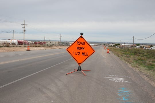 A sign indicates road work on United States Highway 82 near Artesia.