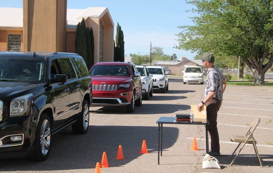 Grace United Methodist Church Pastor Kelly McCuaig prays for a visitor during Grace's drive thru prayer event.  Grace United Methodist Church held a drive thru prayer event Wednesday, April 9.