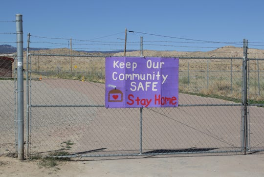 Community members in Sheep Springs are reminded about the stay-at-home order for the Navajo Nation. The sign is pictured on April 5 and is among several placed at the flea market in Sheep Springs.
