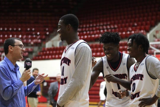 Jeremy Otto interviews a member of the Detroit Mercy basketball team.